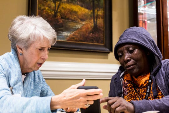 Cathy Richbourg, left, and Andjelani Sima, right, work to identify a word during the English as a Second Language study group session at Trezevant Manor on Nov. 14, 2018.