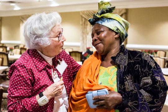 Julia Allen, left, and Janet Nyirabakomeza, right, embrace after the weekly English as a Second Language study group session at Trezevant Manor on Nov. 14, 2018. The group is in partnership with the refugee resettlement agency World Relief Memphis, Allen's group meets at Trezevant every week as an English as a Second Language study group.