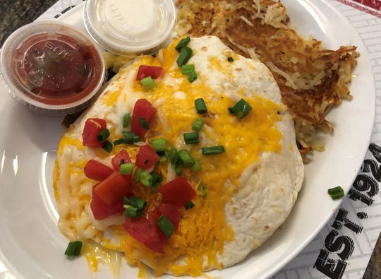 "The ""Huevos Santa Fe"" with hashbrowns at Red Rooster, Marco Island."