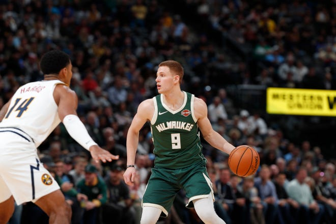 Milwaukee Bucks guard Donte DiVincenzo (9) in the second half of an NBA basketball game Sunday, Nov. 11, 2018, in Denver. Milwaukee won 121-114. (AP Photo/David Zalubowski) ORG XMIT: OTKDZ122