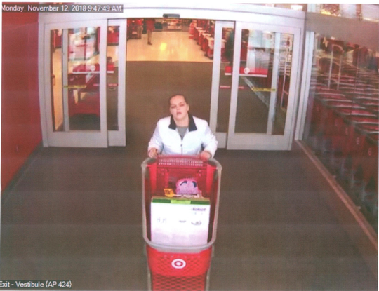 A woman leaves Target with unpaid merchandise. A couple left a Brookfield Target without paying for over $1,000 of merchandise on Nov. 12.