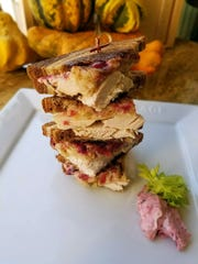 The turkey sandwich can be quartered and stacked for a fun presentation.