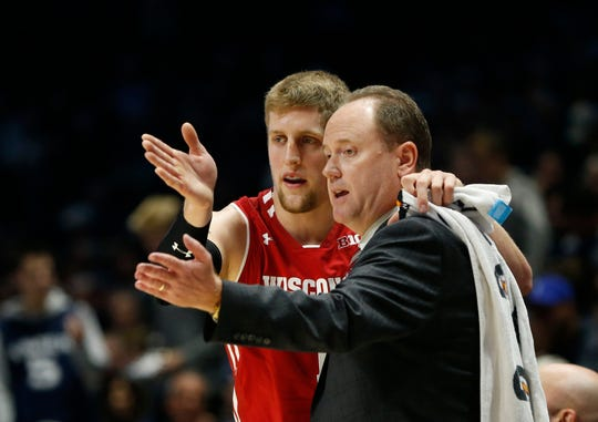 Badgers head coach Greg Gard talks with guard Brevin Pritzl during UW's game against Xavier on Tuesday night.