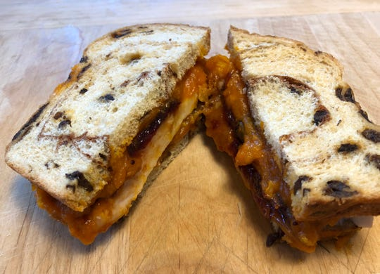 Cinnamon raisin bread and candied yams lend sweetness to this turkey leftovers sandwich, created by Thi Cao at Buckley's.
