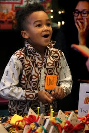 Utezi Kalumbula, 6, talks about the triangle games he made for the Cloud 9 Workshop's Kidpreneur Fair that featured 15 children in grades 1 through 5 selling products they created.