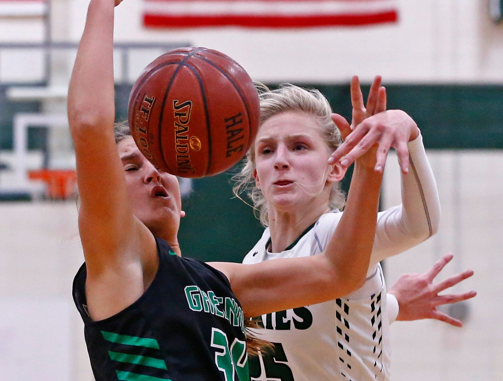 West Allis Hale's Abi Stevens blocks Greendale's Kaitlyn Delong's shot at Hale on Nov. 13