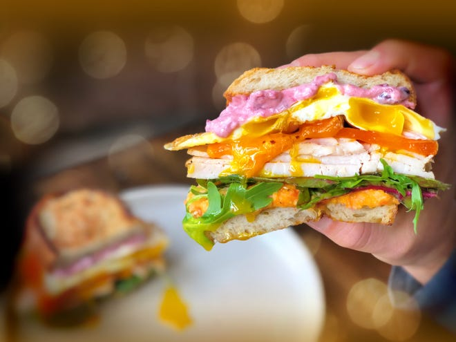 Cranberry aoili, arugula, root veggie mash, turkey in gravy, cheddar cheese and two fried eggs make for a hefty post-Thanksgiving sandwich, created by Shully's Catering.