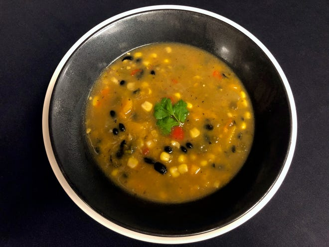 Three Sisters Stew is a melange of corn, beans and squash and much more.