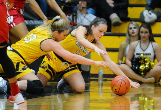 UW-Milwaukee guards Brandi Bisping (left) and Jamie Reit dive for a ball on the Klotsche Center floor.