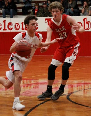 Flippin's Jackson Baker drives past Deer's Caden Young on Tuesday night.