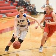 Cotter's Emily Montgomery drives to the basket against Melbourne's Josie Roark on Tuesday night in the Arvest Bank Tournament.