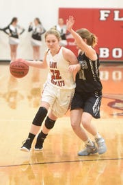 Flippin's Maelee Benedict dribbles against a Jasper defender on Tuesday night.