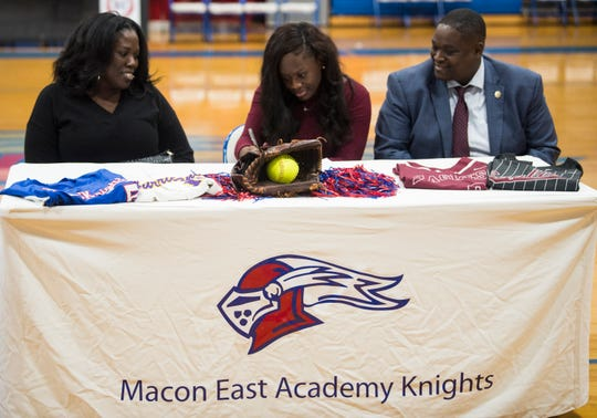 TJ James signs her letter of intent to Costal Alabama softball during signing day at Macon East Academy in Cecil, Ala., on Wednesday, Nov. 14, 2018.