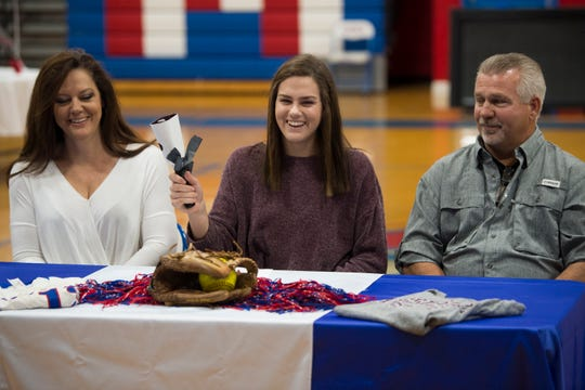 Madisyn Kennedy rings a cow bell after signing her letter of intent to Mississippi State during signing day at Macon East Academy in Cecil, Ala., on Wednesday, Nov. 14, 2018.