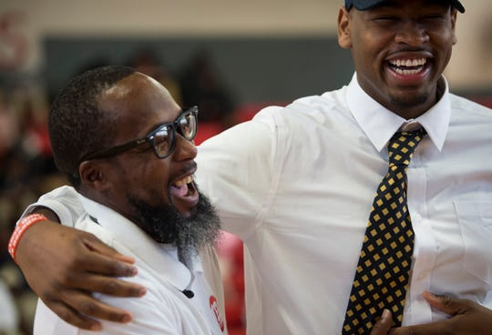 Demond Robinson jokes with his coach Bryant Johnson during signing day at Lee High School in Montgomery, Ala., on Wednesday, Nov. 14, 2018.