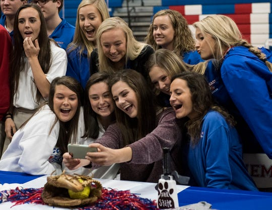 Madisyn Kennedy takes a selfie with her friends during signing day at Macon East Academy in Cecil, Ala., on Wednesday, Nov. 14, 2018.