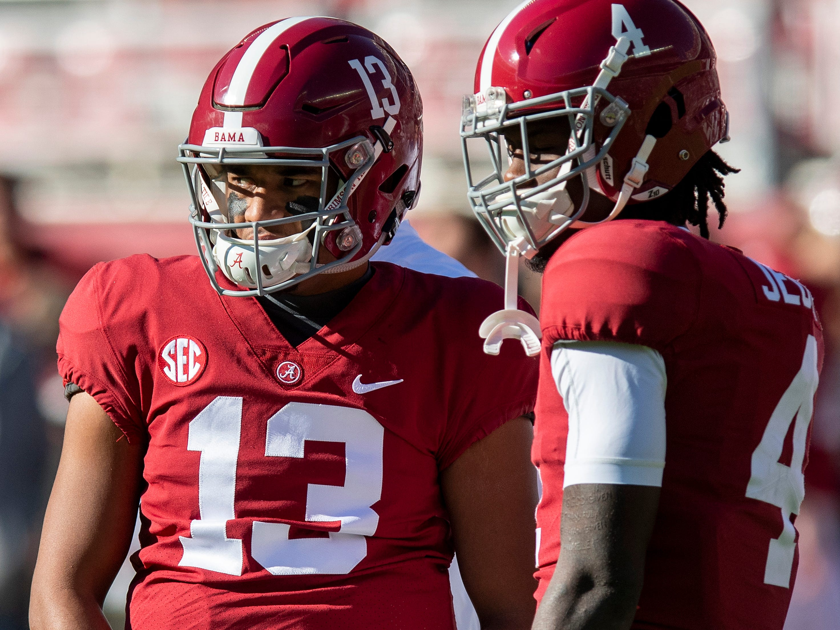 Alabama quarterback Tua Tagovailoa (13) and wide receiver Jerry Jeudy (4) talk before the Alabama vs. Mississippi State game at Bryant Denny stadium in Tuscaloosa, Ala., on Saturday November 9, 2018.