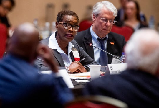 Mayor Elizabeth Carr-Hurst of Fairburn, Ga.,left, and Mayor Frank Cownie of Des Moines, Iowa, take part in discussion during a summit of the U.S. Conference of Mayors in Montgomery, Ala., on Wednesday November 14, 2018 to address extremism, bigotry and divisiveness.
