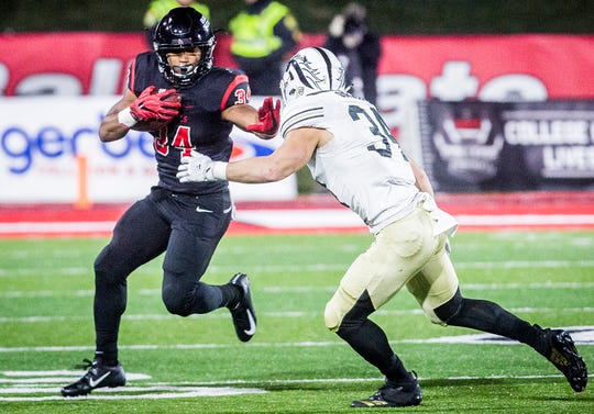Ball State's James Gilbert runs against Western Michigan during their game at Scheumann Stadium Tuesday, Nov. 13, 2018.
