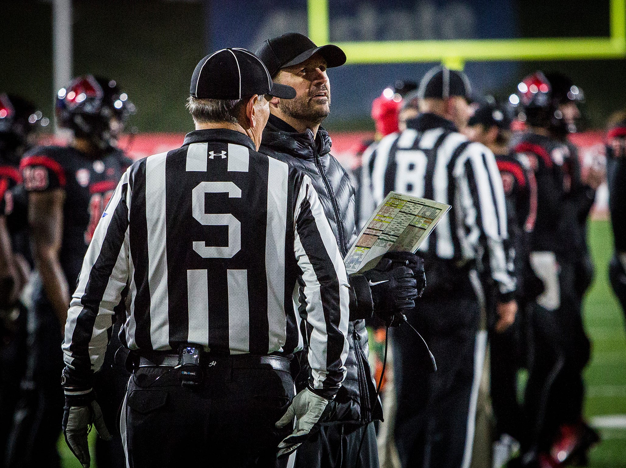 Ball State's Mike Neu talks to a ref during the game against Western Michigan during their game at Scheumann Stadium Tuesday, Nov. 13, 2018.