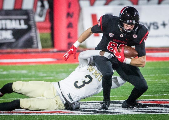 Ball State's Riley Miller tries to break free from a tackle against Western Michigan during their game at Scheumann Stadium Tuesday, Nov. 13, 2018.