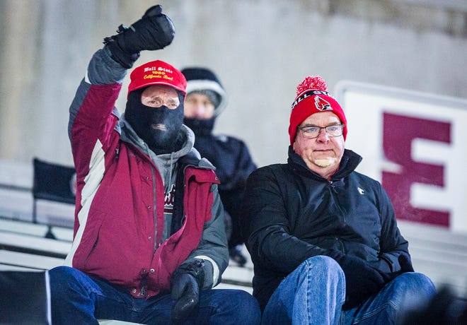 Ball State fans Mark Lazzer and Mike Taite cheer on the Cardinals against Western Michigan during their game at Scheumann Stadium Tuesday, Nov. 13, 2018.