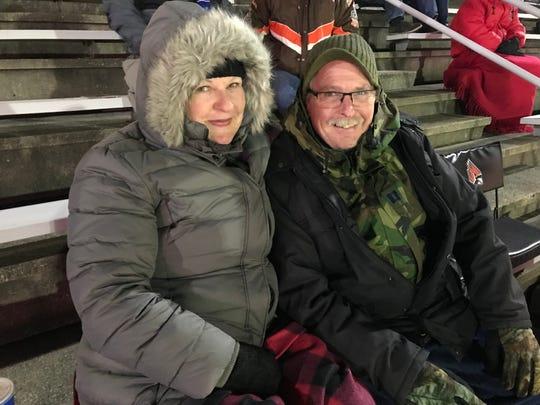 Ball State fans Cathy Purtlebaugh, left, and Ron Purtlebaugh cheer on the Cardinals against Western Michigan on Nov. 13, 2018 at Scheumann Stadium.