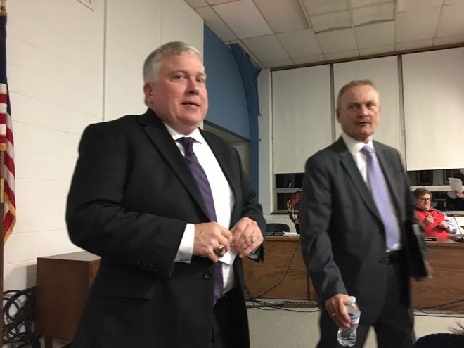 New CFO of Muncie Community Schools Bradley DeRome (left) and former CFO Paul Pflederrer mix with the crowd after a school board meeting on Tuesday night. Photo by Seth Slabaugh/The Star Press
