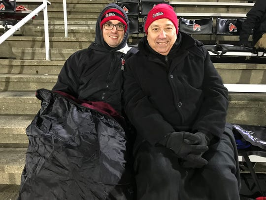 Ball State fans Andy Morrow, left, and Mark Popovich cheer on the Cardinals against Western Michigan on Nov. 13, 2018 at Scheumann Stadium.
