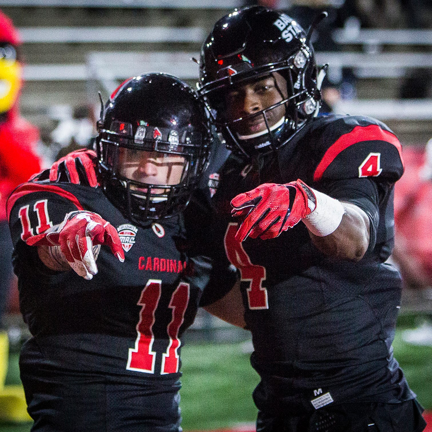 Ball State's Corey Lacanaria, left, and Malik Dunner celebrate a touchdown against Western Michigan during their game at Scheumann Stadium Tuesday, Nov. 13, 2018.