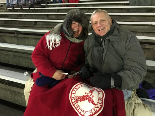 Ball State fans Pam Addison, left, and Marvin Addison cheer on the Cardinals against Western Michigan on Nov. 13, 2018 at Scheumann Stadium.