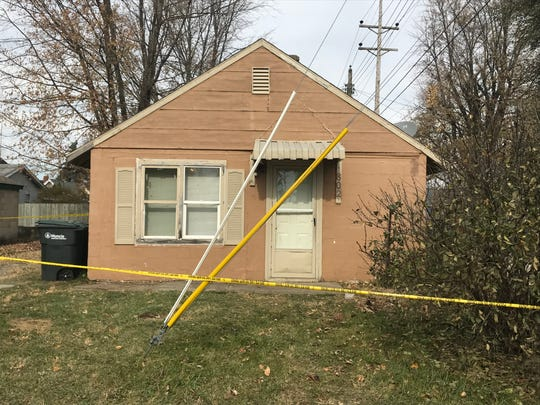 Crime scene tape surrounds a home at 820 E. 25th St., where city police early Wednesday found a Muncie man suffering from a severe gunshot wound.