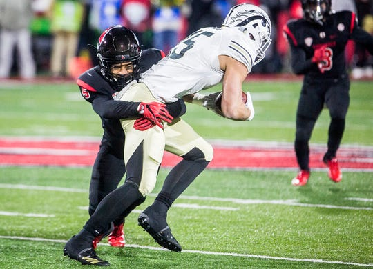Ball State's Bryce Cosby makes a tackle against Western Michigan during their game at Scheumann Stadium Tuesday, Nov. 13, 2018.