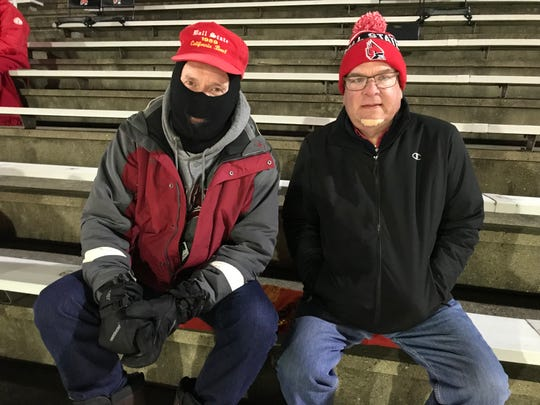 Ball State fans Mark Lazzer, left, and Mike Taite cheer on the Cardinals against Western Michigan on Nov. 13, 2018 at Scheumann Stadium.