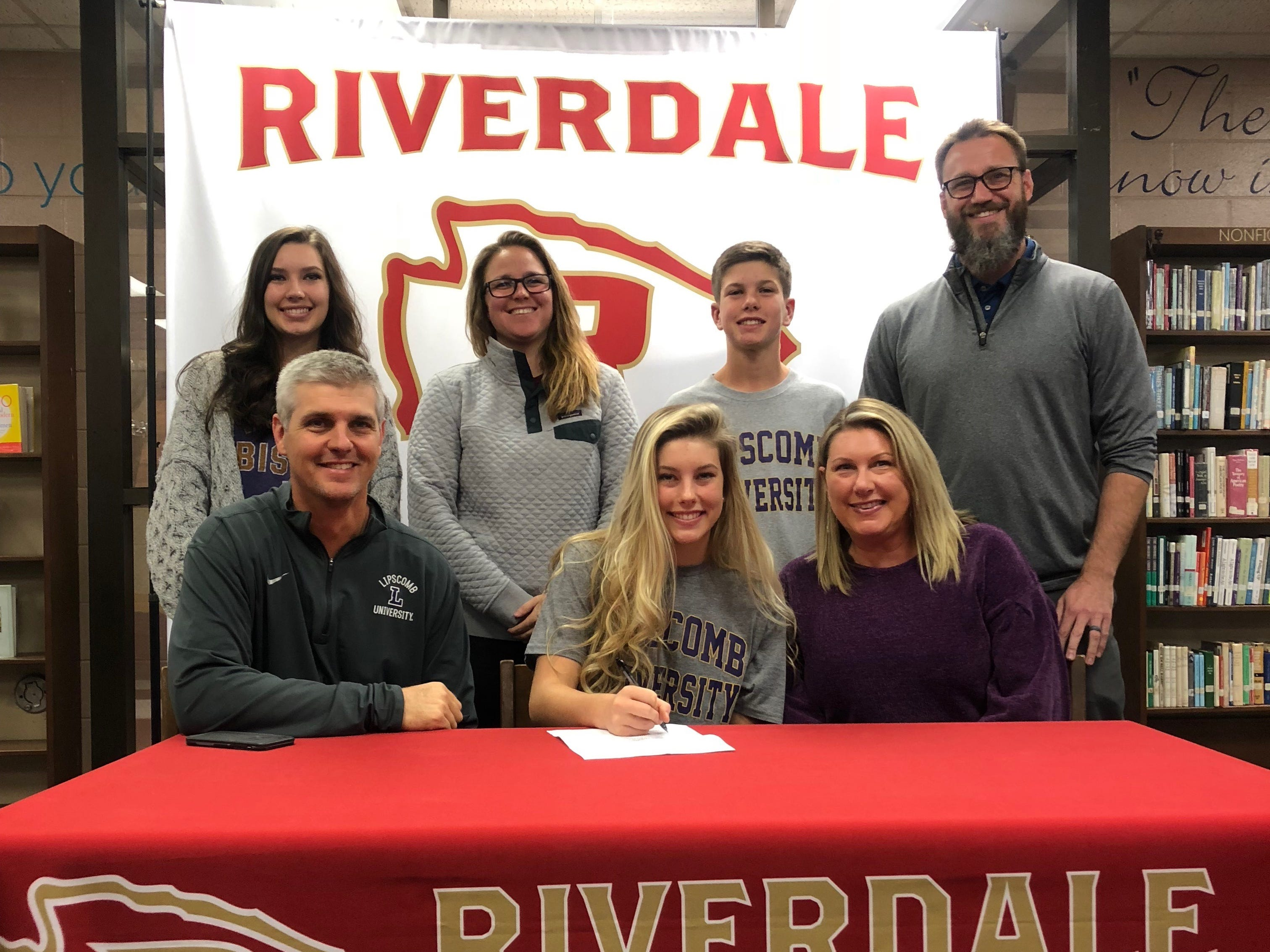 Riverdale's Jalyn Holcomb signed to play basketball at Lipscomb Wednesday. Pictured in the front row are (l-r) father Kelly Holcomb, Jalyn, mother Lorie Holcomb. In the back row are sister Kellyn Holcomb, Riverdale coach Amy Josephson, brother Jameson Holcomb and Riverdale assistant principal Lee Nachand.
