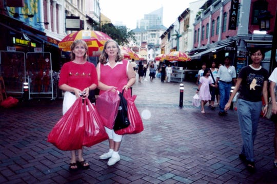 Shopping sisters Jacci Rodgers and Marcia Thorpe in Singapore.