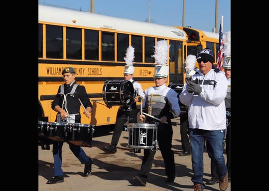 New Fairview High Band Director Mark Kinzer (right) prepares the band for marching in Fairview's Second Annual Veterans Day Parade November 10, 2018.