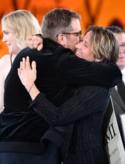"Keith Urban hugs songwriter Busbee after their song ""The Fighter"" was honored at BMI's 2018 Country Music Awards Tuesday Nov. 13, 2018, in Nashville, Tenn."