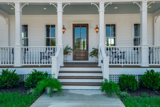 Stephens Valley is designed to encourage front-porch living. This is a DeFatta Custom Homes front porch.