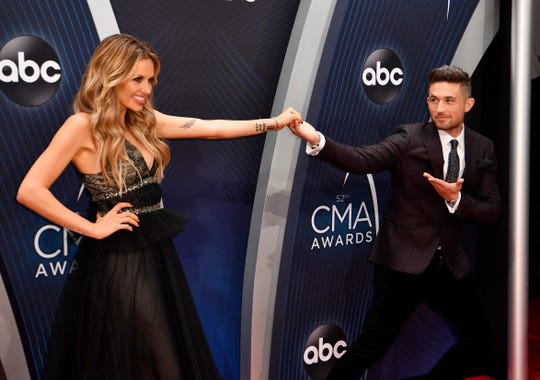 Carly Pearce and Michael Ray clown around on the red carpet before the 52nd Annual CMA Awards at Bridgestone Arena Wednesday, Nov. 14, 2018, in Nashville, Tenn.