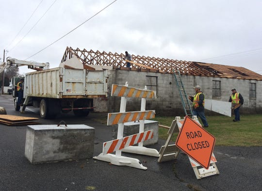 City of Dickson Public Works employees remove the roof from an old block building in the space near Dickson Fire Station No. 1, at the corner lot of College and Church streets in Downtown Dickson, in November of 2018. The now-vacant site is being discussed as a possible location for a new skate park.