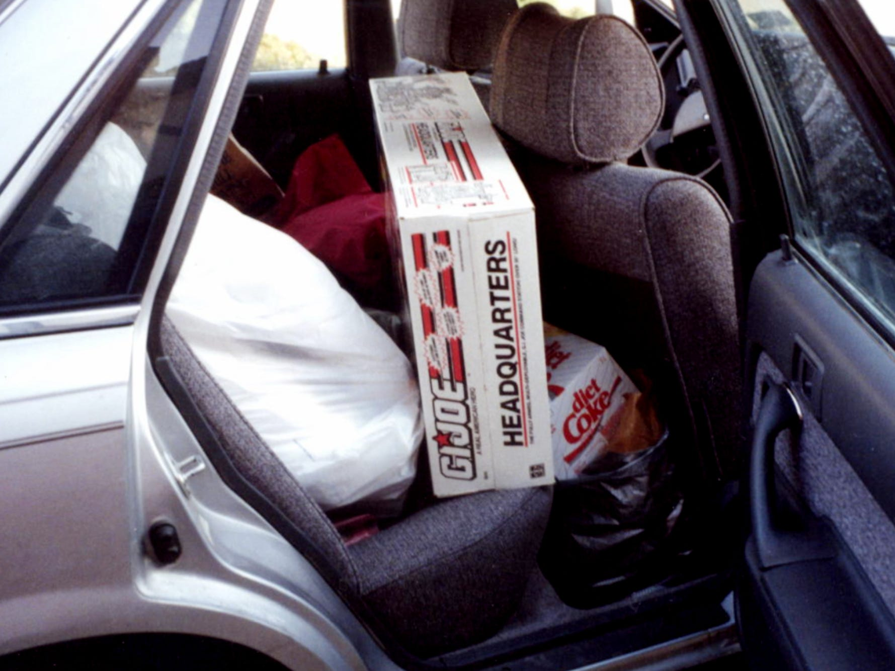 Jacci Rodgers and Marcia Thorpe pack the car after shopping Mall of America on Black Friday.