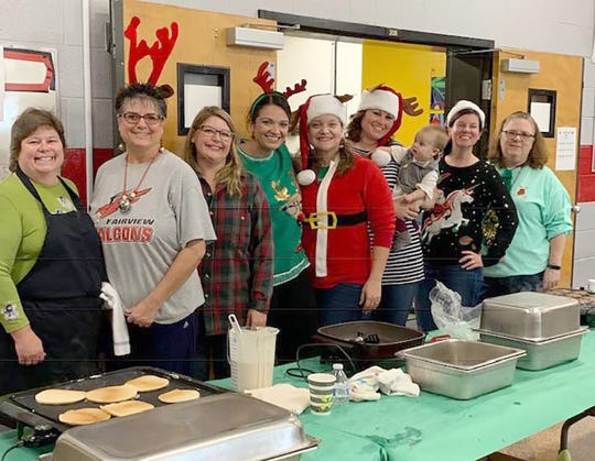 Fairview Middle School teachers and volunteers assist with the pancake breakfast held in conjunction with the FMS Holiday Bazaar.