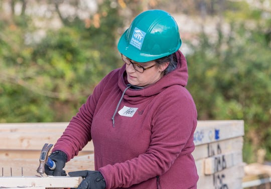 Ande Truman helps build the Habitat for Humanity home in Dickson for Jennifer Meade.