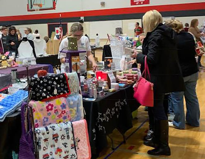 Shoppers enjoy browsing vendor booths at the annual FMS Holiday Bazaar.