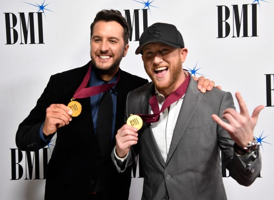 Luke Bryan and Cole Swindell on the red carpet at BMI's 2018 Country Music Awards Tuesday Nov. 13, 2018, in Nashville, Tenn.