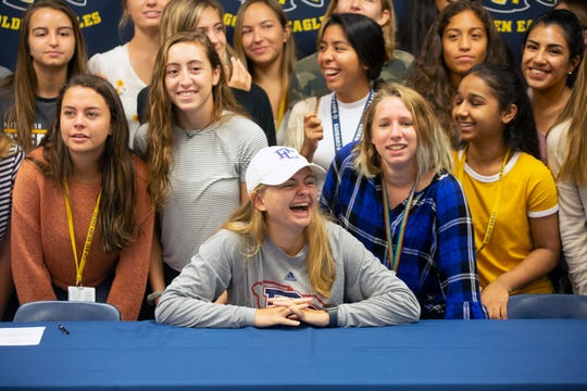 Sophie Sullinger poses for photos after her signing her letter of intenet, Wednesday, Nov. 14, 2018 at Naples High School.