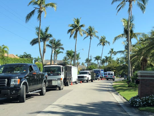 Commercial vehicles line Rum Road in Port Royal. The Naples City Council unanimously voted Monday to prohibit commercial vehicles from parking on the neighborhood's streets.