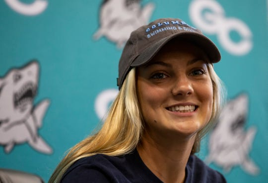 Olivia Ricard, a Gulf Coast High School diver, signs the National Letter of Intent during the College Signing Day at the media centre of Gulf Coast High School on Wednesday, Nov.14, 2018. Ricard will be attending Columbia University next fall.