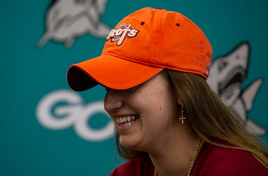 Marina Hodo, a Gulf Coast High School basketball player, blushes as the announcer states her achievements, while she signs the National Letter of Intent during the College Signing Day at the media centre of Gulf Coast High School on Wednesday, Nov.14, 2018. Hodo will be attending Maryville College next fall.